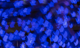 Blue arrow shape bokeh background of city light Royalty Free Stock Photography