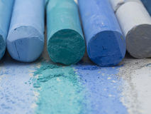 Blue artistic crayons. Dry pastels in the line Stock Image