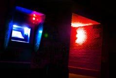 Blue ATM at night in a dark street, criminal activity, danger of thieves. Blue ATM at night in a dark street, criminal activity, danger of stock images