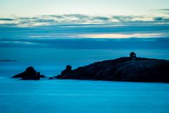 Quiberon coastline in France. Blue atmosphere over Quiberon in Brittany, just after sunset Royalty Free Stock Photography