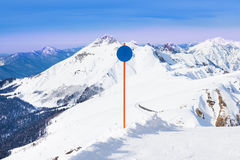 Blue attention sign on winter Caucasus mountains Stock Images