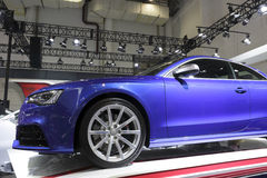 Blue audi cs5 car side view Royalty Free Stock Photos