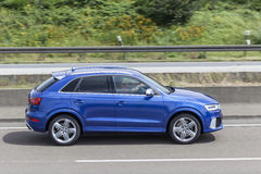 Blue AUDI Q3 on the road Royalty Free Stock Image