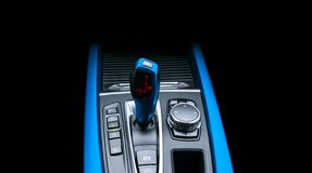 Blue Automatic gear stick of a modern car. Modern car interior details. Close up view. Car detailing. Automatic transmission lever stock images