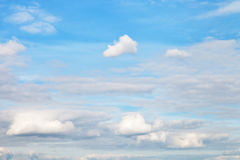 Blue autumn sky with layer of white clouds Royalty Free Stock Photo