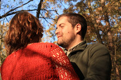 Blue autumn sky with young man looking at woman face Royalty Free Stock Images