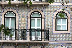 Blue azulejos on the buildings in Lisbon, Portugal. Azulejo is a form of Spanish and Portuguese painted tin-glazed ceramic tilework. Azulejos are found on the Royalty Free Stock Photo