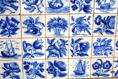 Blue azulejos on the buildings in Lisbon, Portugal. Azulejo is a form of Spanish and Portuguese painted tin-glazed ceramic tilework. Azulejos are found on the Stock Photos