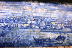 Blue azulejos on the buildings in Lisbon, Portugal. Azulejo is a form of Spanish and Portuguese painted tin-glazed ceramic tilework. Azulejos are found on the Stock Image