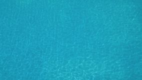 Blue azure transparent water of a swimming pool on sunny day stock video