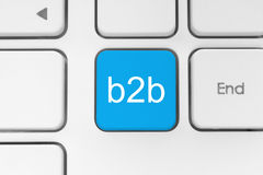 Blue B2B (business to business) button. On keyboard close-up stock illustration