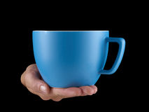 Blue - baby blue color cup - mug on black background. Stock Images