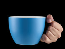 Blue - baby blue color cup - mug on black background. Woman hand holding an gentle blue - baby blue color cup - mug on black background Royalty Free Stock Photo