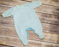 Blue baby bodysuit Stock Photos