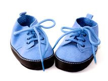 Blue baby booties. Isolated on white Stock Images
