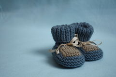 Blue baby booties Stock Photo