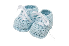 Blue Baby Booties. Baby booties on a white background, blue boy baby booties royalty free stock photo
