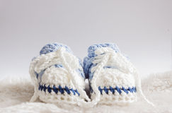 Blue baby booties Stock Images