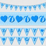 Blue baby boy flags and ribbon bunting set Stock Photos