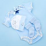 Blue baby clothes for infant boy. Blue infant boy clothing for baby shower Royalty Free Stock Photo