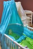 Blue baby cot Stock Photos