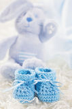 Blue baby crochet shoes Stock Photo
