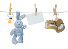 Blue baby goods and blank note. Hanging on the clothesline stock photo
