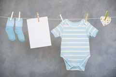Baby on the clothesline Stock Photos