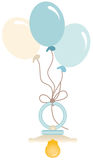 Blue baby pacifier with balloons Royalty Free Stock Photography