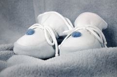 Blue Baby Shoes on Blanket Royalty Free Stock Image