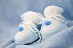 Blue Baby Shoes on Blanket Stock Images