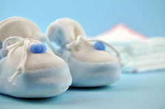 Blue Baby Shoes and Cotton Diapers Royalty Free Stock Photos