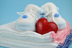 Blue Baby Shoes on Cotton Diapers Royalty Free Stock Photo