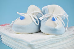 Blue Baby Shoes on Cotton Diapers Stock Image