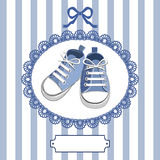 Blue baby shoes and frame Royalty Free Stock Photos