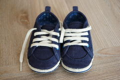 Blue baby shoes Stock Images