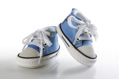 Blue baby shoes with reflection Royalty Free Stock Images