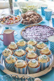 Blue baby shower cup cakes. Bilberry pie and other sweets, at a party table royalty free stock images