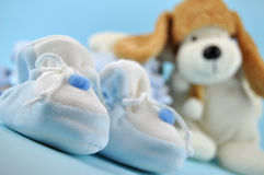 Blue Baby Slippers and Toy Dog Royalty Free Stock Photos