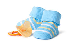 Blue baby socks and pacifier. On a wihite background royalty free stock photos