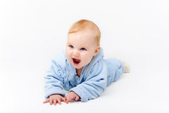 Blue baby in a studio. Baby in blue outfit looking happily in a studio Stock Photography