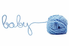 Blue baby word made of yarn isolated. On white Stock Image