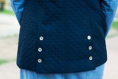 Blue back vest. Buttons on dark blue waistcoat Stock Photography