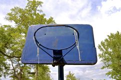 Blue backboard and rim in outdoor basketball Stock Image