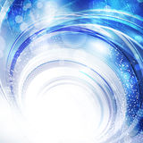 Blue background. Abstract wintry blue background with a swirl Royalty Free Stock Image