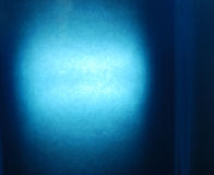 Blue background. A sheet of paper illuminated by flash with blue filter installed Stock Image