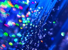 Blue background of abstract brilliance. The unfocused blue background of abstract brilliance for text, banner, poster, label, sticker, wallpaper, layout royalty free stock photography
