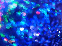 Blue background of abstract brilliance. The unfocused blue background of abstract brilliance for text, banner, poster, label, sticker, wallpaper, layout royalty free stock photo