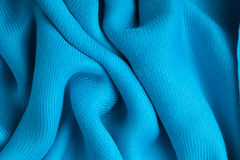 Blue background abstract cloth wavy folds of textile texture Royalty Free Stock Photo