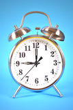 Blue background on alarm clock Stock Photos